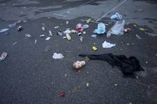 -                A mannequin's head, bottles and and other debris lie in the Madrid Arena venue car park Madrid, Thursday Nov. 1, 2012. Three women have been killed and two injured in a stampede during