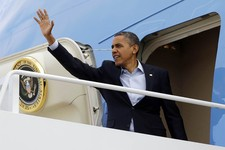 -                President Barack Obama waves as he boards Air Force One before his departure from Andrews Air Force Base, Sunday, Nov. 4, 2012. Just two days from the finish, Obama's campaign is mobili