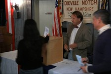 -                In this still frame made from video, voters drop their ballots in the ballot box after casting their votes in Dixville Notch, N.H., Tuesday, Nov. 6, 2012, as they cast the first Electio