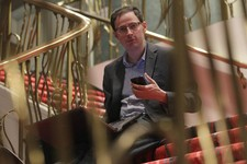 -                Nate Silver holds his phone as he sits on the stairs with his laptop computer at a hotel in Chicago on Friday, Nov. 9, 2012. The 34-year-old statistician, unabashed numbers geek, author