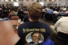 -                In this Nov. 6, 2012 photo, United Auto Workers member Harry Van Uden attends a rally on Election Day at the UAW Region 1 technical training center in Warren, Mich. Only a couple of wee
