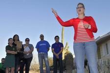 -                FILE - In a Monday, Nov. 5, 2012 file photo, former Democratic Arizona State Sen. and Arizona congressional candidate Kyrsten Sinema addresses residents in a neighborhood in Mesa, Ariz.