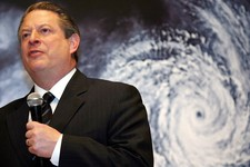 "-                FILE - In this Monday, Jan. 15, 2007 file photo, former U.S. Vice President Al Gore speaks in front of a poster for his documentary film on global warming, ""An Inconvenient Truth,"" duri"