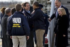-                President Barack Obama is greeted by New York Gov. Andrew Cuomo upon his arrival at JFK International Airport in New York Thursday, Nov. 15, 2012, before taking a aerial tour of damage