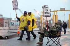 -                Port workers represented by SEIU Local 1021 take part in a 24-hour strike at the Port of Oakland in Oakland, Calif.,  in the early morning hours on Tuesday, Nov. 20, 2012   (AP Photo/Th