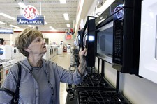 -                In this  Thursday, Oct. 25, 2012,  photo, Mary Ann Rotolo shops for a microwave oven at Orville's Home Appliances store in Amherst, N.Y. U.S. companies in October increased their orders