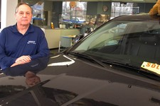 -                Joe Settineri , owner of Merrick Dodge Chrysler Jeep of Wantagh, N.Y., stands beside a recently sold Jeep. The car dealer says sales have been extraordinary in the weeks since Superstor