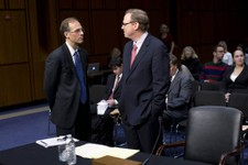 -                Mark Zandi, chief economist at Moodys Analytics, left, speaks with Kevin Hassett, senior fellow and director of Economic Policy at the American Enterprise Institute (AEI), on Capitol Hi