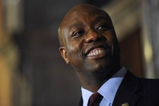 -                U.S. Rep. Tim Scott smiles during a press conference announcing him as Jim DeMint's replacement in the U.S. Senate at the South Carolina Statehouse on Monday, Dec. 17, 2012, in Columbia