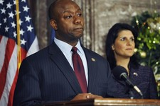-                United States Rep. Tim Scott, left, speaks during a news conference as South Carolina Gov. Nikki Haley looks on at the Statehouse on Monday, Dec. 17, 2012, in Columbia, S.C.  Haley anno