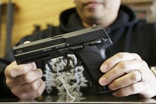 -                General manager Steve Alcairo holds an HK USP 9mm handgun while being interviewed at High Bridge Arms Inc. in San Francisco, Wednesday, Dec. 19, 2012. Anxious parents reeling in the wak