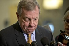 -                Sen. Dick Durbin, D-Ill., a member of the Senate Foreign Relations Committee, pauses as he speaks to reporters following a closed-door briefing on the investigation of the deadly Sept.