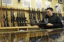-                General manager Steve Alcairo holds a Winchester 1200 shotgun while being interviewed at High Bridge Arms Inc. in San Francisco, Wednesday, Dec. 19, 2012. Anxious parents reeling in the