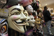 "-                FILE - In this Oct. 21, 2011 file photo, masks, including ""V for Vendetta,"" left, are displayed at a Ricky's Halloween store in New York. Television audiences across China watched an an"