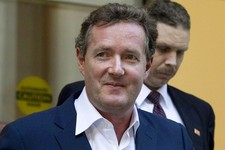 "-                FILE - In this Dec. 20, 2011 file photo, Piers Morgan, host of CNN's ""Piers Morgan Tonight,"" leaves the CNN building in Los Angeles.  More than 31,400 people have signed a petition call"