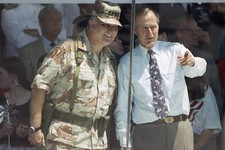 -                FILE - In this June 8, 1991 file photo, Gen. Norman Schwarzkopf and President George Bush watch the National Victory Parade from the viewing stand in Washington. Schwarzkopf led his tro