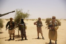 -                FILE - In this April 24, 2012 file photo, fighters from Islamist group Ansar Dine stand guard during a hostage handover in the desert outside Timbuktu, Mali. In recent months, al-Qaida