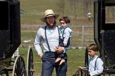 -                HOLD FOR STORY Freeman Burkholder carries his son to the school house for the end of the school year celebration in Bergholz, Ohio on Tuesday, April 9, 2013.  Burkholder is one of the A