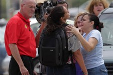 -                Lone Star College student Michelle Alvarez, second from right, is examined by her aunt Elena Tokarew, right,  after the stabbings at Lone Star College's Cypress-Fairbanks campus Tuesday