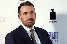 "-                FILE - In this Tuesday, April 9, 2013 publicity photo provided by Fiji Water, actor Ben Affleck arrives at the premiere of ""To The Wonder"" hosted by FIJI Water, in Los Angeles. Affleck"