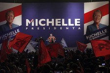 -                Chile's former President Michelle Bachelet greets supporters after being officially named as candidate for the presidency by the Socialist Party and the Party for Democracy in Santiago,