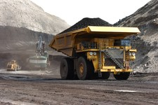 -                In this April 4, 2013 photo, a truck carrying 250 tons of coal hauls the fuel to the surface of the Spring Creek mine near Decker, Mont.  From the time coal is blasted from strip mines