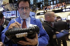 -                FILE - In this Feb. 8, 2013, file photo, Trader Peter Costa, left, works on the floor of the New York Stock Exchange in New York. The U.S. economy is recovering from the Great Recession