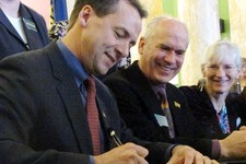 -                Montana Gov. Steve Bullock, left, state Sen. Tom Facey and advocate Linda Gryczan attend a ceremony signing into law a gay rights bill that has been in the works for two decades on Thur