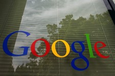-                FILE- This April 12, 2012, photo shows a Google logo on a window at the company's headquarters in Mountain View, Calif. Google's latest quarterly results reported Thursday, April 18, 20