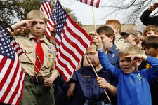 "-                FILE - In this Feb. 6, 2013 file photo, from left, Joshua Kusterer, 12, Nach Mitschke, 6, and Wyatt Mitschke, 4, salute as they recite the pledge of allegiance during the ""Save Our Scou"
