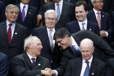 -                U.S. Treasury Secretary Jack Lew, right, shakes hands with German's Finance Minister Wolfgang Schaeuble during a group photo of the G20 finance ministers and central bank governors on t