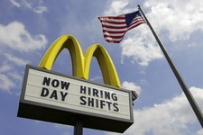 -                FILE- This May 2, 2012, file photo shows a sign advertising job openings outside a McDonalds restaurant in Chesterland, Ohio. McDonald's Corp. reports quarterly financial results before