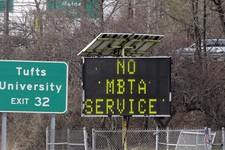 -                A sign along I-93 in Medford, Mass. announces no MBTA service Friday, April 19, 2013. Two suspects in the Boston Marathon bombing killed an MIT police officer, injured a transit officer