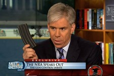 "-                This image made from video provided by NBC's ""Meet the Press"" shows host David Gregory holding what he described as a high-capacity ammunition magazine during the taping of the Sunday,"