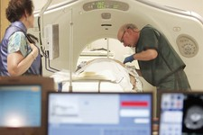 -                FILE - In this June 3, 2010 file photo, Dr. Steven Birnbaum works with a patient in a CT scanner at Southern New Hampshire Medical Center in Nashua, N.H. The American Cancer Society say