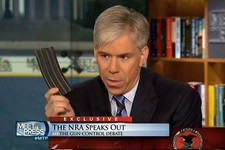 "-                This video frame grab image provided by""Meet the Press"" shows host David Gregory holding what he described as a high-capacity ammunition magazine during a recent Sunday's program.  Greg"