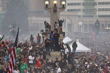 -                Members of a crowd numbering tens of thousands smoke marijuana and listen to live music, at the Denver 420 pro-marijuana rally at Civic Center Park in Denver on Saturday, April 20, 2013