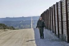 -                In this Monday, March 25, 2013 photo, Border Patrol agent Richard Gordon, a 23-year veteran of the agency, walks the border fence in the Boulevard area east of San Diego looking for sig