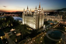 -                FILE- In this April 27, 2006, file photo, the sun sets behind the Mormon Temple, the centerpiece of Temple Square, in Salt Lake City. The annual spring ritual of bank shareholder meetin