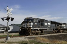 -                In this Tuesday, Oct. 9, 2012, photo, a Norfolk Southern Railroad train pulls transport cars full of coal near Goodfield, Ill. Norfolk Southern Corp. reports quarterly financial results
