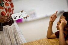 -                In this Thursday, April 18, 2013 photo, Burgess-Peterson Elementary School second grader Carl Hood, right, sits through a lesson with instructor Lola Onikoyi as part of Atlanta Public S