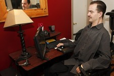 -                FILE - In this Dec. 6, 2012 file photo, Brandon Coats works on his computer at his home in Denver. Coats, a quadriplegic medical marijuana patient, was fired from his job in 2010 as a t