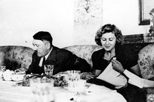 -                FILE - This undated file picture shows the German Fuehrer Adolf Hitler and his mistress Eva Braun while dining. A German woman named Margot Woelk was one of 15 young women who sampled H