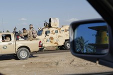 -                FILE - in this Tuesday, April 23, 2013 file photo, Iraqi army soldiers stage on the outskirts of Hawija, 150 miles (240 kilometers) north of Baghdad, Iraq. A shadowy militant group link