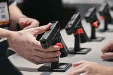 -                FILE - In this Wednesday, Jan. 16, 2013 file photo, a Glock representative explains features of the Glock 37 Gen 4 .45 caliber pistol at the 35th annual SHOT Show, in Las Vegas. After s