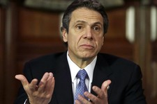 -                FILE - In this file photo of Jan. 2, 2013,  New York Gov. Andrew Cuomo gestures during a news conference in the  at the Capitol in Albany, N.Y. On Monday, April 29, 2013, Cuomo said on