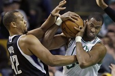 -                FILE - In this Jan. 30, 2013, file photo, Boston Celtics center Jason Collins, right, struggles for control of the ball with Sacramento Kings forward Chuck Hayes (42) during the second