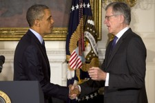 -                President Barack Obama shakes hands with his nominee for Federal Housing Finance Authority (FHFA), Tom Wheeler, in the State Dining Room of the White House in Washington, Wednesday, May