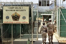 -                FILE -  In this June 27, 2006 file photo, reviewed by a US Department of Defense official, US military guards walk within Camp Delta military-run prison, at the Guantanamo Bay US Naval