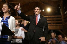 -                Republican candidate for the U.S. Senate Gabriel Gomez, center, gives a thumbs up as he takes to the stage next to his daughter Olivia, 13, left, before addressing an audience with a vi